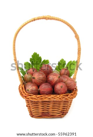 Gooseberries in fruit basket with green leaves