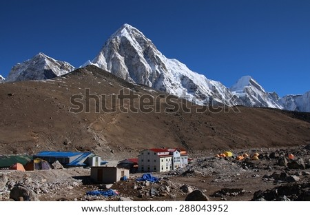Gorak Shep and high mountains Pumo Ri and Lingtren - stock photo