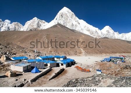 Gorak Shep village, mount Pumo Ri and Kala Patthar, way to Kala Patthar and Mount Everest base camp, Sagarmatha national park, Khumbu valley, Nepal - stock photo