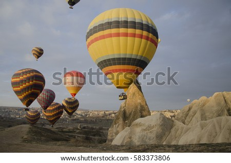 GOREME, CAPPADOCIA, TURKEY - February 14, 2016: Cappadocia, Turkey.The greatest tourist attraction of Cappadocia, the flight with the hot air balloons over the valley in Goreme