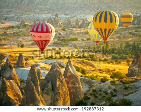 GOREME, TURKEY - AUGUST 25: Hot air balloon fly over Cappadocia on august 25, 2013 in Goreme, Cappadocia, Turkey - stock photo
