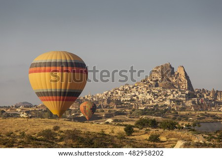 GOREME, TURKEY - AUGUST 28: Hot air balloon fly over Cappadocia on august 28, 2016 in Goreme, Cappadocia, Turkey.