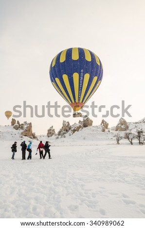 GOREME, TURKEY - DECEMBER, 2013: Hot air balloon fly over Cappadocia in Goreme in winter. - stock photo