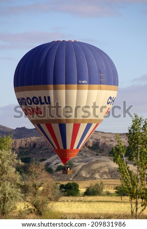 GOREME, TURKEY - June 13, 2014: Hot air balloon fly over Cappadocia in Goreme, Cappadocia, Turkey