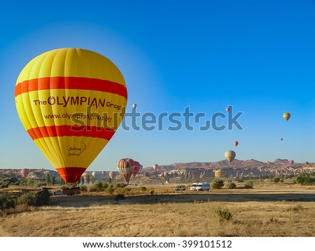 Goreme, Turkey, sep 7, 2011: Colorful hot air balloons flying over and landing at the Cappadocia valley, Anatolia, Turkey. Volcanic mountains in Goreme national park.