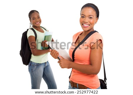 gorgeous african college girl in front of her friend on white background - stock photo