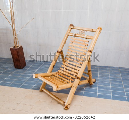 gorgeous amazing beautiful stylish natural bamboo chair standing on ceramic floor - stock photo