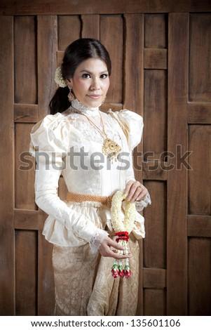 Gorgeous asian woman in thai dress - stock photo