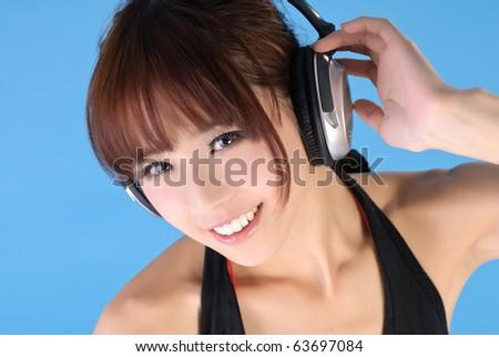Gorgeous Asian woman smiling, closeup portrait over blue background. - stock photo