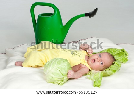 Gorgeous baby and watering can