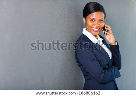 gorgeous black businesswoman talking on mobile phone - stock photo