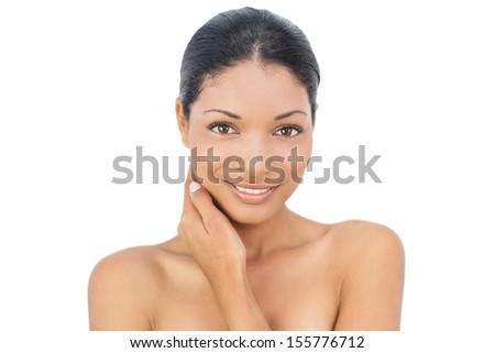 Gorgeous black haired model posing on white background - stock photo