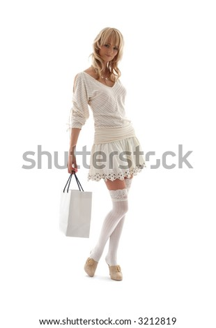 gorgeous blond with shopping bag over white - stock photo