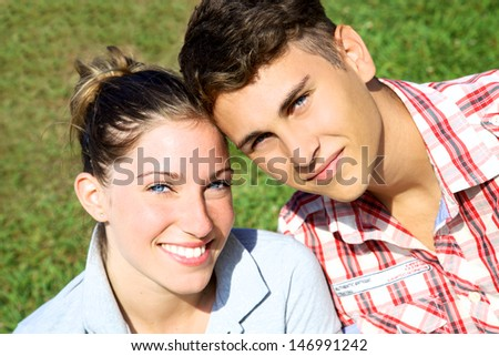 Gorgeous blonde female model happy smiling with handsome boy with blue eyes