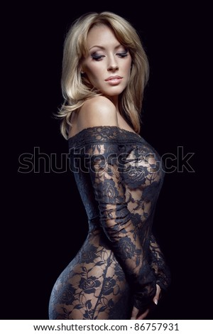 gorgeous blonde in lace dress, isolated on black, studio shot - stock photo