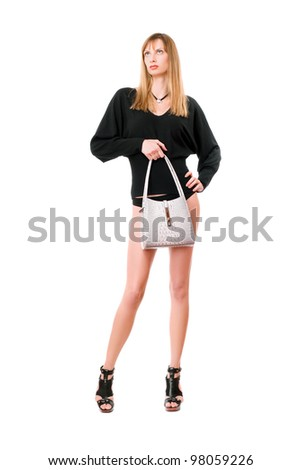 Gorgeous blonde lady with the white purse - stock photo