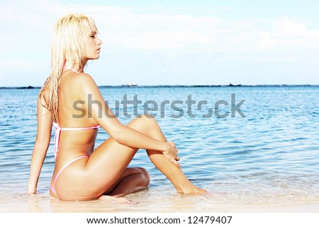 gorgeous blonde posing on tropical beach - stock photo