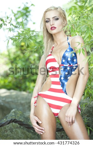 Gorgeous Blonde Wearing American Flag Swimsuit - stock photo