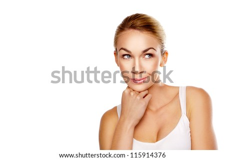 Gorgeous blonde woman daydreaming with a lovely gentle smile on her face as she thinks beautiful thoughts isolated on white - stock photo