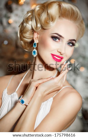 Gorgeous Blonde Woman with retro hairstyle and makeup in luxury interior, elegant sexy girl with wedding makeup in vintage style. Beauty and Jewelry model. Rich vogue woman in fur. - stock photo
