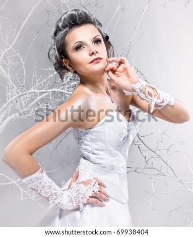 Gorgeous bride on winter background - stock photo
