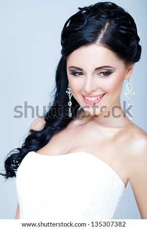 Gorgeous bride smiling - stock photo