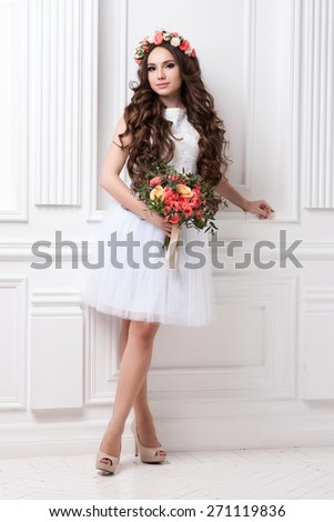 Gorgeous bride with flowers - stock photo