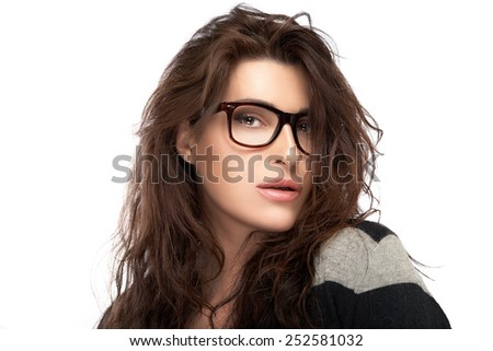 Gorgeous brunette fashion model girl with casual style wearing trendy glasses. Cool trendy eyewear portrait isolated on white background with copy space - stock photo