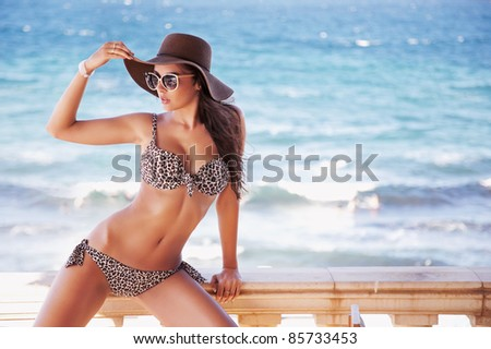 Gorgeous brunette on vacation day - stock photo