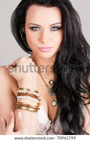 Gorgeous brunette with long hair posing on white background - stock photo