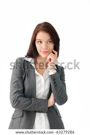 Gorgeous business woman thinking - stock photo