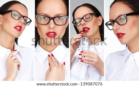 Gorgeous businesswoman with red lips and eyeglasses posing in front of camera - stock photo