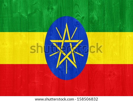 gorgeous Ethiopia flag painted on a wood plank texture