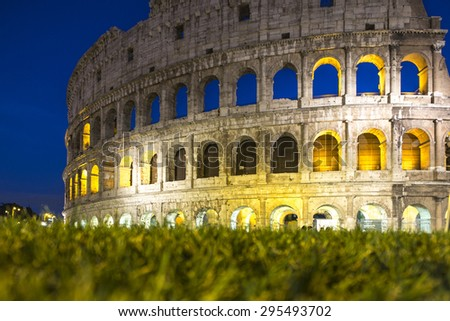 Gorgeous evening Coliseum or Amphitheatrum Flavium with bright illumination on blue sky background, Rome, Italy