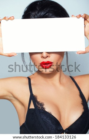 Gorgeous face with a blank sign - stock photo