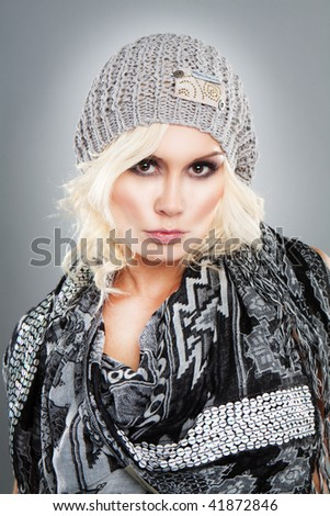 Gorgeous Fashion Model with Hat On Grey