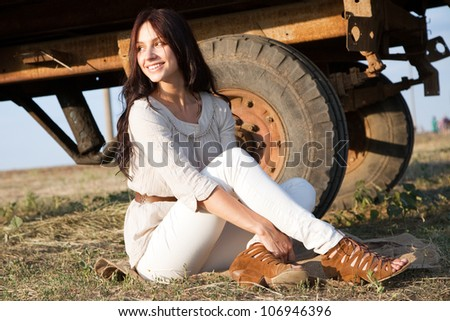 Gorgeous fashionable woman in countryside