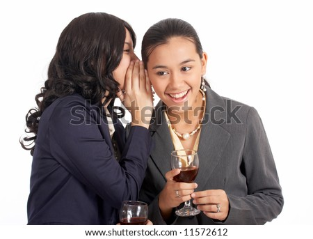 gorgeous female secretary whispering something to her co-worker - stock photo