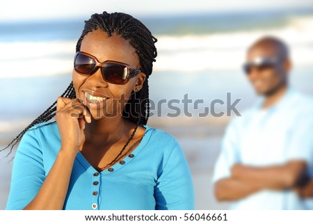 Gorgeous girl in sunglasses poses outdoors - stock photo