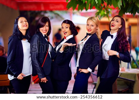 gorgeous girls posing in black suits - stock photo
