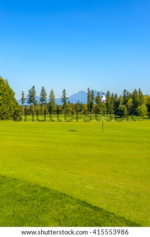 Gorgeous green at the beautiful golf course. - stock photo