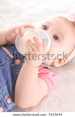 gorgeous infant drinking bottle - stock photo