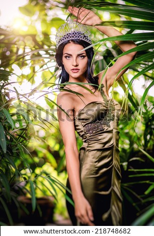 Gorgeous lady in long evening dress and with tiara on a head  - stock photo
