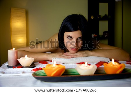 Gorgeous lady laying on massage table relaxing - stock photo