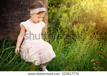 Gorgeous little girl outdoors in forest - stock photo
