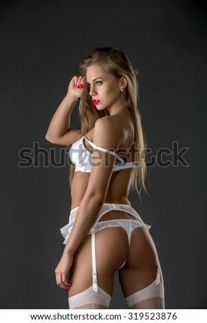 Gorgeous model dressed in erotic bridal underwear - stock photo