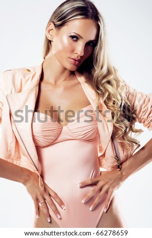 Gorgeous model in fashionable clothing is posing seductively - stock photo