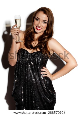 Gorgeous Model Smiling in a club with Champagne - stock photo