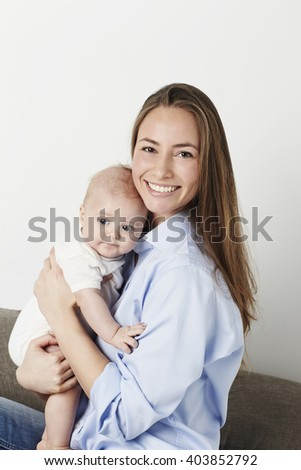 Gorgeous mother holding baby son, portrait - stock photo