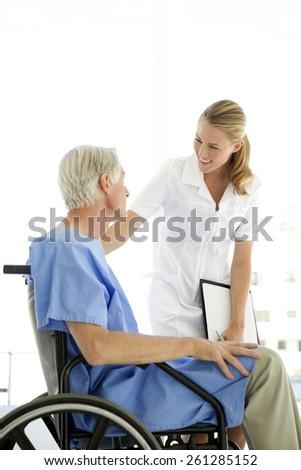 Gorgeous nurse with senior patient - stock photo